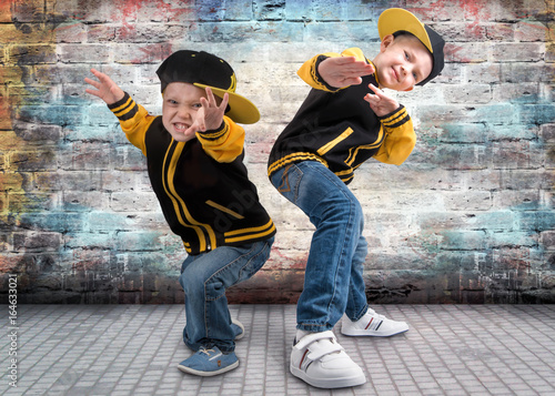 Fotografie, Obraz  Two brothers dancing break dance.Hip-hop style.The cool kids.