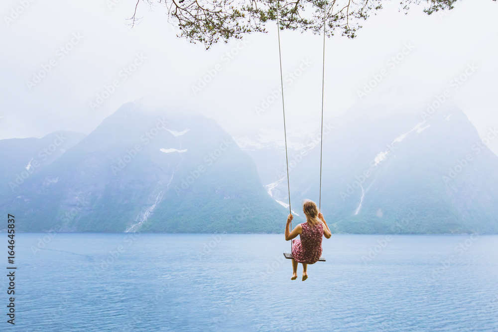 Fototapety, obrazy: romantic beautiful girl on swing in Norway, happy dreamer, inspiration background