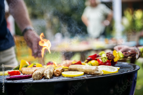 Aluminium Prints Grill / Barbecue Closeup of cooking homemade barbecue on charcoals grill
