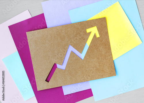 Fotografia, Obraz  Up Arrow Graph on Brown Paper