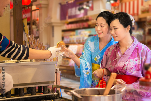 Asian girls hand of dessert during festival event Canvas Print