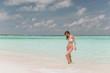 Beautiful girl on the beach on the island