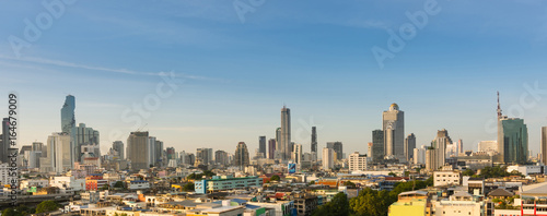 In de dag Milan Panorama of cityscape buildings and skyscrapers of downtown luxury hotel with blue sky in bangkok thailand.