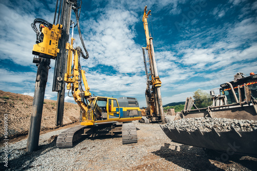 Fotografía Highway construction site with heavy duty machinery