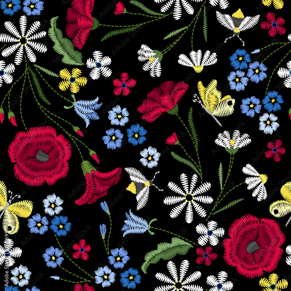 Embroidery seamless pattern with beautiful flowers. Vector floral ornament on black background. Embroidery for fashion textile and fabric.