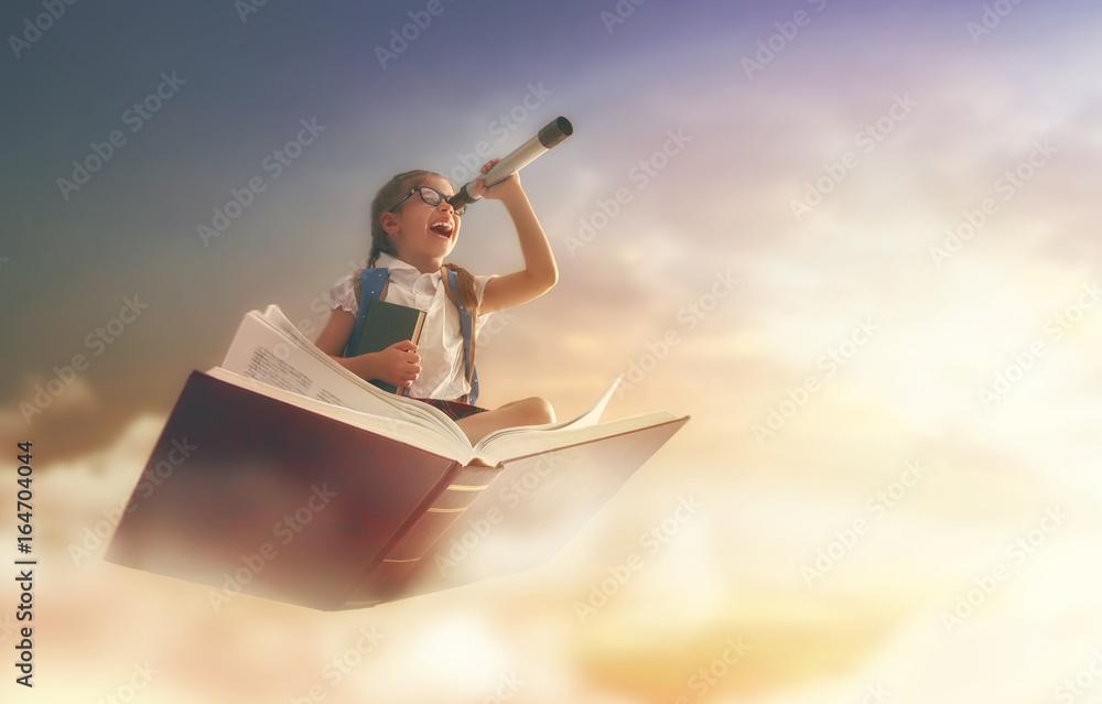Fototapeta child flying on the book