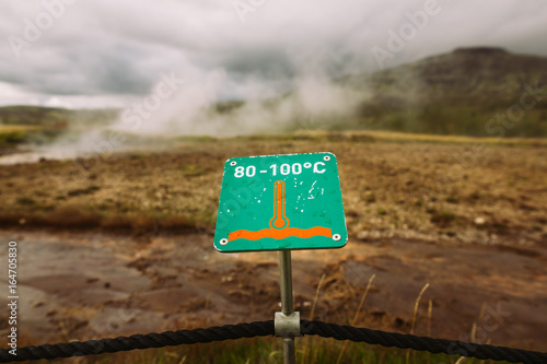 Warning sign of hot earth Caution of high temperature on golden