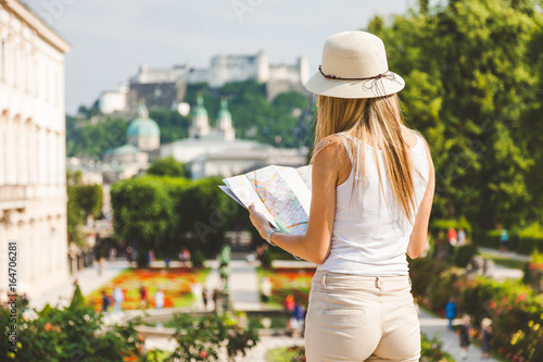Photo  Female tourist on vacation in Salzburg Austria holding a local map