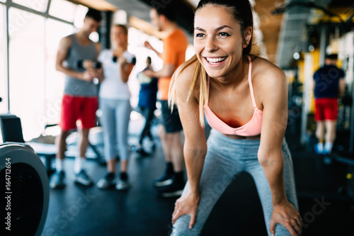 Spoed Foto op Canvas Fitness Close up image of attractive fit woman in gym