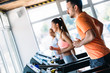 canvas print picture - Group of friends exercising on treadmill machine