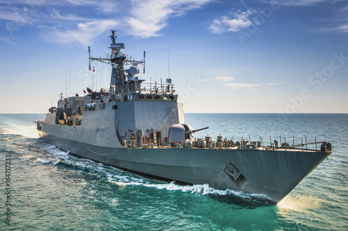Grey modern warship sailing in the sea Wallpaper Mural