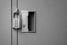 Closeup Padlock With Key Number Hanging On Locker For Concept Technology Data Log Security On Black And White