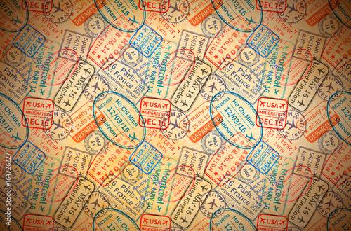 Fotografija  Colorful International travel visa rubber stamps imprints on old paper, horizont