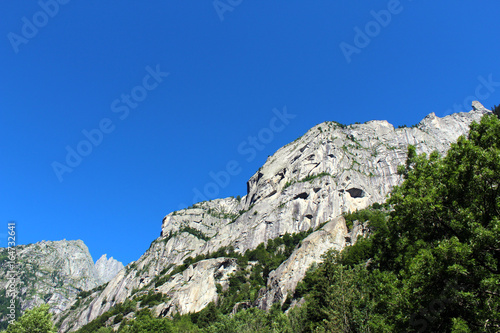 Granite rocks mountain walls in an alpine valley (Val di Mello batholith) Wallpaper Mural