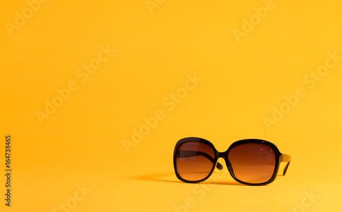 Big black sunglasses on a yellow background