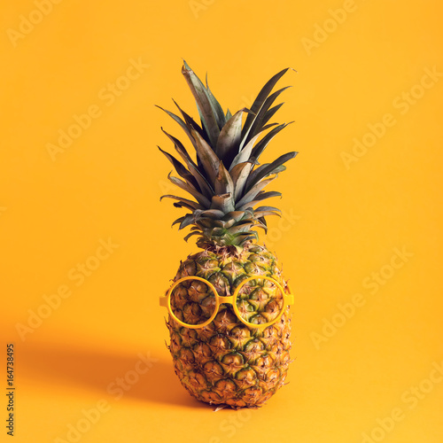 Fototapety, obrazy: Whole pineapple with glasses on a bright yellow background