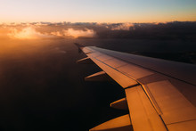 Sun Shining From The Corner Of Image On The Aircraft Wing With L