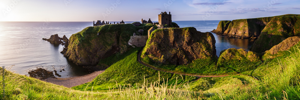 Fototapeta Panoramic view of Dunottar Castle at sunrise on the East Coast of Scotland. Aberdeenshire, United Kingdom