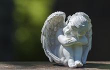 Child Angel Statue On Gravestone