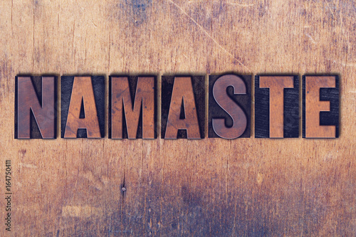 Photo  Namaste Theme Letterpress Word on Wood Background