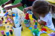 child draws paints
