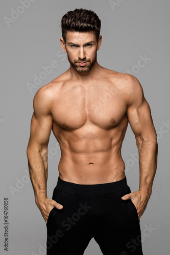 Fitness male model posing Wall mural
