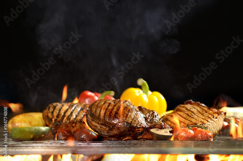 In de dag Grill / Barbecue Grilled meat /steak with vegetable on the flaming grill