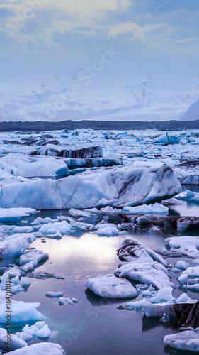 sun light reflecting on iceberg glacier lagoon, jokulsarlon of Iceland