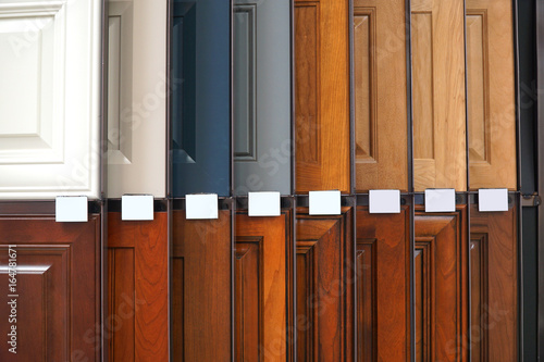 Obraz na plátně wood cabinet door samples in market in a row