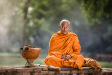 Asian Monk Meditating Under A ...