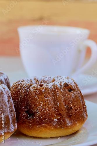 Fotografie, Obraz  Appetizing raisins muffin and coffee