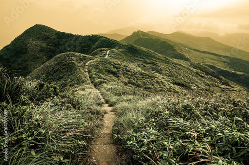 Photo Storybook landscape of a footpath through rolling hills on the Caoling Historic