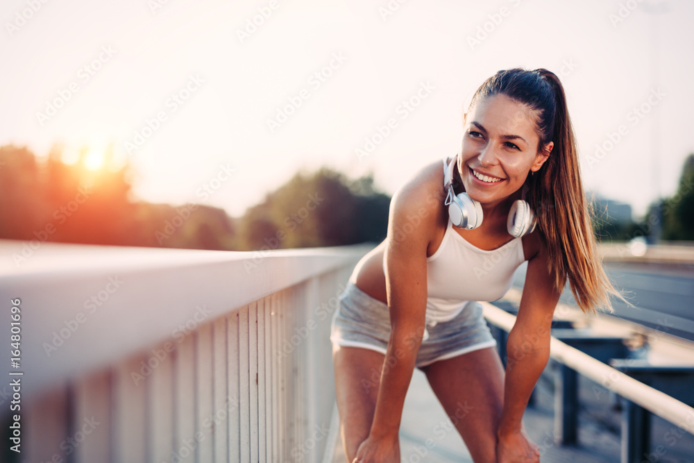 Fototapety, obrazy: Portrait of woman taking break from jogging