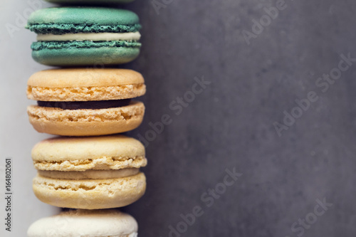 Keuken foto achterwand Bakkerij Colorful assorted french macaroons on a gray concrete background.