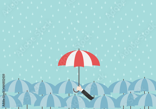 9115344f3346a Businessman hold up umbrella under the rain. Step up to leadership in  business. Hand holding a red umbrella over blue umbrellas. Raining  background.