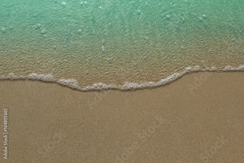 Photo sur Toile Plage wave on sand beach with copy space,concept for beach background.