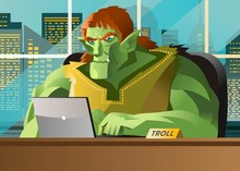 Angry Troll Using A Computer In The Office