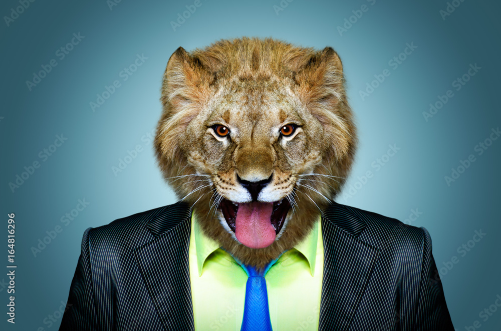 Portrait of a lion in a business suit on a blue background