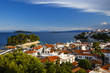 View of the old harbour on Skiathos island and Euboea in the distance, Greece.