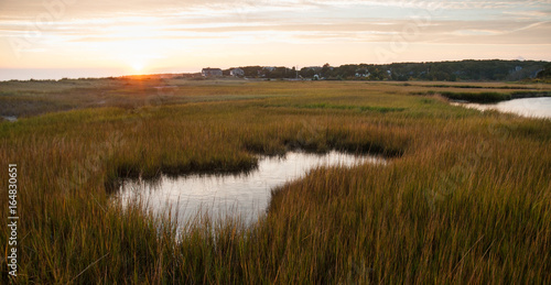Photo Sunset on Cape Cod with tide pool and marsh grasses in foreground