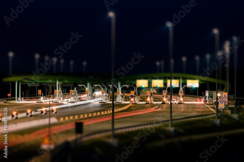 highway toll booth at night - tilt shift effect