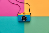 Fashion Film Camera. Hot Summer Vibes. Pop Art. Creative Retro Design camera. Hipster Trendy Accessories. Sunny summer Still life. Bright Sweet fashion Style. Surreal, Minimal Fun.Vanilla Pastel Color - 164841280