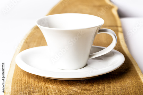 One Pure White Ceramic Cup And Saucer Stands On A Wooden Table Buy