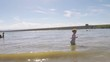 Little girl playing on the beach at Cherry Creek reservoir in the Summer