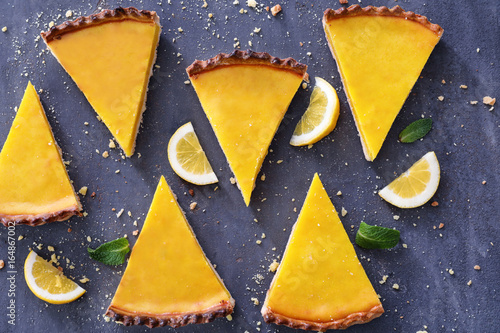 Fotografie, Obraz  Composition with pieces of delicious lemon pie on textured background