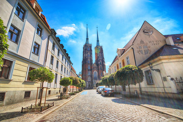Fototapeta WROCLAW, POLAND - JULY 18, 2017: Wroclaw Old Town. Cathedral Island (Ostrow Tumski) is the oldest part of the city. Historic buildings on a summer day. Capital of Lower Silesia, Poland, Europe.