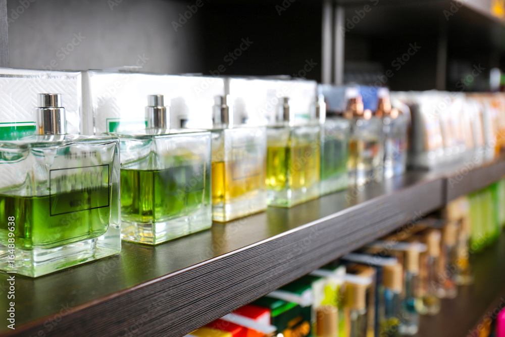 Fototapety, obrazy: Shelving with different perfume in modern shop
