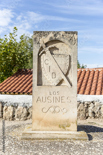 Photo  Camino del Cid signpost with a shield and a sword in Los Ausines, Burgos, Spain