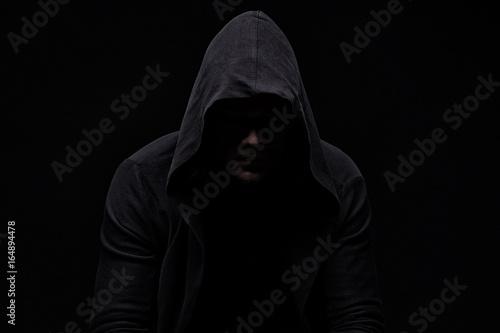Cuadros en Lienzo Young man in hood and shadow
