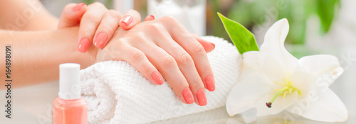 Foto op Aluminium Manicure Manicure concept. Beautiful woman's hands with perfect manicure at beauty salon.